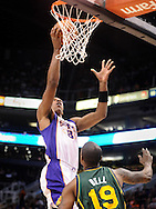 Mar. 14, 2012; Phoenix, AZ, USA; Phoenix Suns forward Channing Frye (8) puts up a shot against the Utah Jazz guard Raja Bell (19) during the first half at the US Airways Center. Mandatory Credit: Jennifer Stewart-US PRESSWIRE..