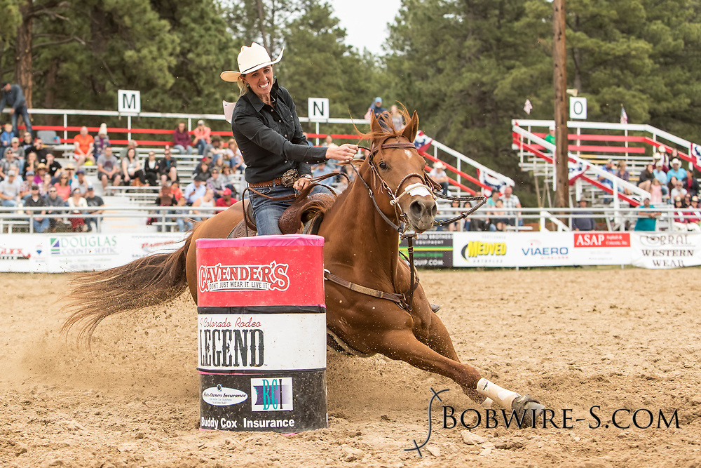Sally Conway makes her barrel racing run during the third performance of the Elizabeth Stampede on Sunday, June 3, 2018.