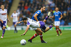 Christian Burgess of Portsmouth receives a yellow card for a tackle on Jon Taylor of Rotherham United - Mandatory by-line: Jason Brown/JMP - 03/09/2017 - FOOTBALL - Fratton Park - Portsmouth, England - Portsmouth v Rotherham United - Sky Bet League Two