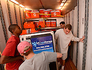 Equipment managers work in the Mal Moore Athletic Facility to get the University of Alabama football team ready for the trip to Baton Rouge to face LSU.  Student equipment managers help Jack Vickers (rigth rear) load out the trailer of his 18 wheel rig.  Photo by Gary Cosby Jr.