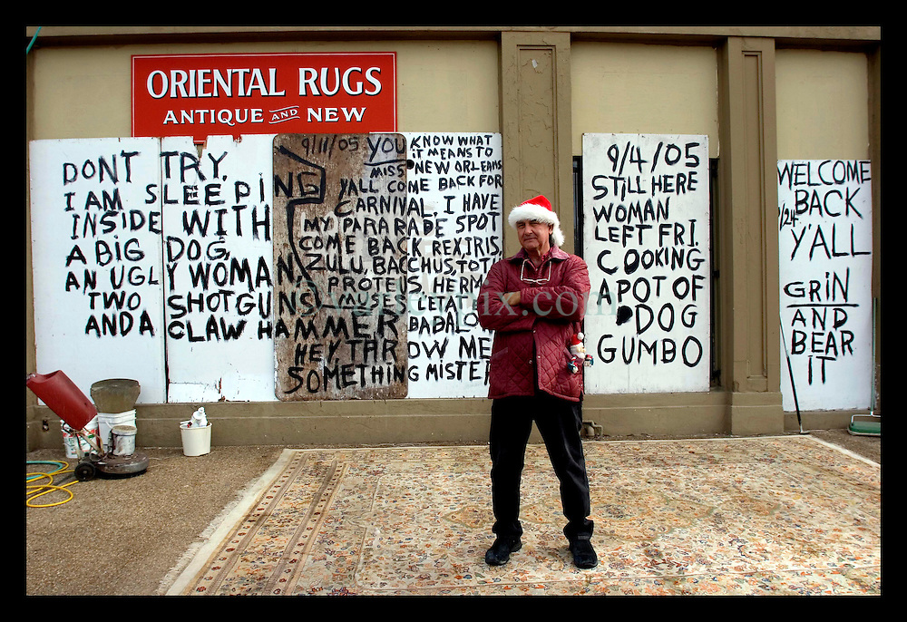 9th December, 2005. New Orleans, Louisiana. Bob Rue, survivor of Hurricane Katrina stayed at Sarouk Shop, his home and business on St Charles Ave where he painted his philosophies on the chip board outside for passers by to read.