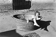 child in tin tub 1960s