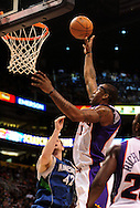 Mar. 16 2010; Phoenix, AZ, USA; Phoenix Suns forward Amare Stoudemire (1) puts up a shot against Minnesota Timberwolves forward Kevin Love (42) in the second half at the US Airways Center.  The Suns defeat the Timberwolves 152-114. Mandatory Credit: Jennifer Stewart-US PRESSWIRE.