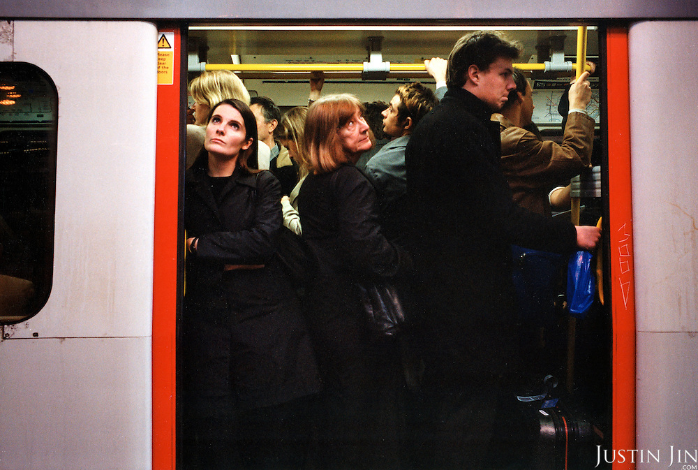 Passengers are squashed at the gate of a London underground train during rush hour..Picture taken 2005 by Justin Jin