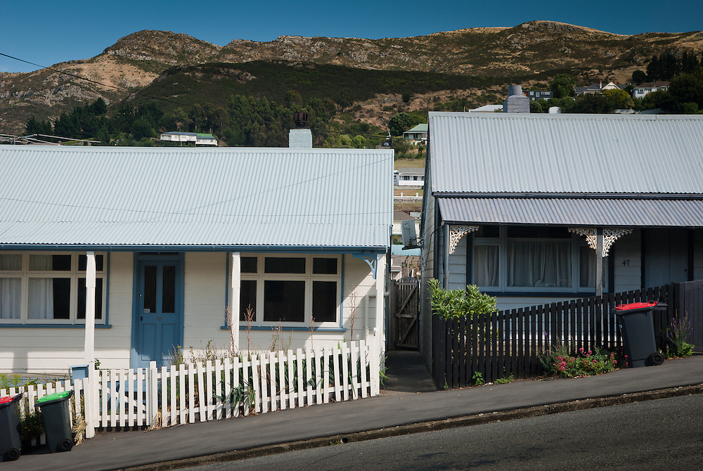 Typical 19th century colonial-style cottages, with tin roof, veranda and picket fence, Lyttleton NZ