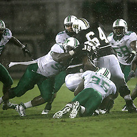 Central Florida running back Ronnie Weaver (35) gets gang tackled during an NCAA football game between the Marshall Thundering Herd and the Central Florida Knights at Bright House Networks Stadium on Saturday, October 8, 2011 in Orlando, Florida. (Photo/Alex Menendez)