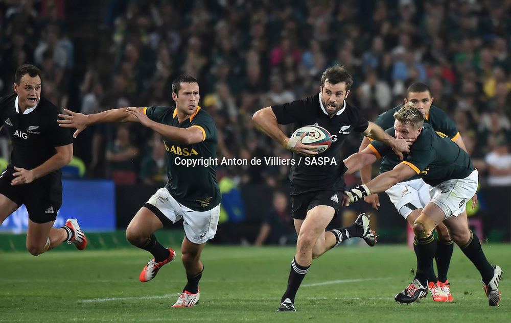 JOHANNESBURG, South Africa, 04 October 2014 : Conrad Smith of the All Blacks gets away from Jean de Villiers (C) and Jan Serfontein (left) of the Springboks during the Castle Lager Rugby Championship test match between SOUTH AFRICA and NEW ZEALAND at ELLIS PARK in Johannesburg, South Africa on 04 October 2014. <br /> The Springboks won 27-25 but the All Blacks successfully defended the 2014 Championship trophy.<br /> <br /> &copy; Anton de Villiers / SASPA