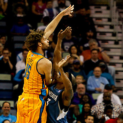 Jan 11, 2013; New Orleans, LA, USA; New Orleans Hornets center Robin Lopez (15) shoots over Minnesota Timberwolves power forward Dante Cunningham (33) during  the second quarter of a game at the New Orleans Arena. Mandatory Credit: Derick E. Hingle-USA TODAY Sports