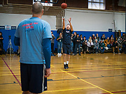 12 DECEMBER 2019 - DES MOINES, IOWA: ANDREW YANG takes a shot against J.D. SCHOLTEN during a basketball game with Scholten in the gym in the Ames, IA, City Hall. Scholten is an Iowa Democrat running against Republican Congressman Steve King. Yang, an entrepreneur, is running for the Democratic nomination for the US Presidency in 2020. He brought bus tour to Ames, IA, Thursday. Iowa hosts the the first election event of the presidential election cycle. The Iowa Caucuses will be on Feb. 3, 2020.      PHOTO BY JACK KURTZ