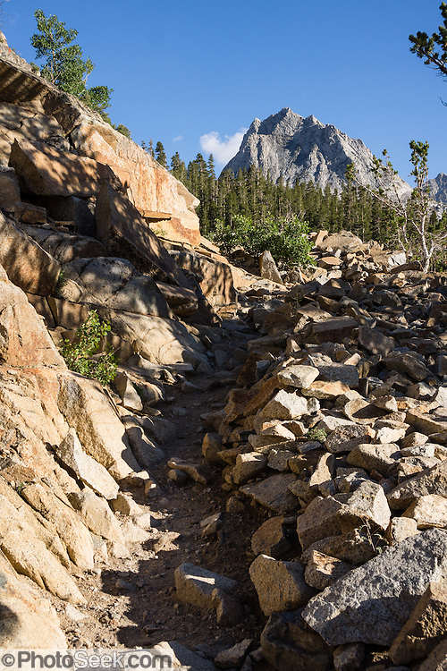 Hurd Peak (12,237 feet) is one of many impressive mountains along the trail to Bishop Pass, in Inyo National Forest, Sierra Nevada, California, USA. My favorite hike in the Bishop Creek watershed goes from South Lake to Long Lake and Saddlerock Lake, looping back via a steeper, poorly marked route to Ruwau Lake, Chocolate Lakes, and Bull Lake, in John Muir Wilderness, Inyo National Forest, Sierra Nevada, California, USA. The rewarding semi-loop is 9 miles with 2220 feet cumulative gain. An easier walk is 7.2 miles round trip with 1500 feet gain to Saddlerock Lake, out and back via beautiful Long Lake.