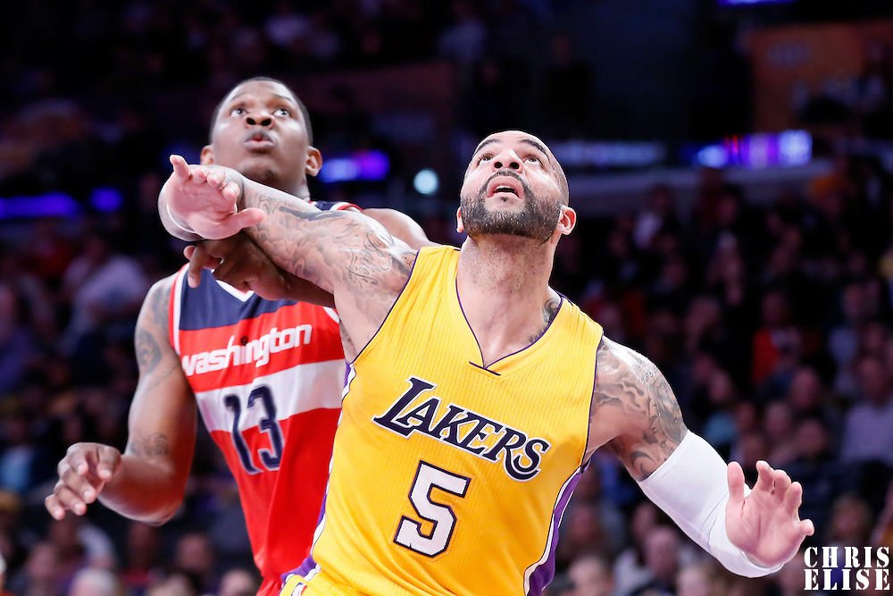 27 January 2015: Los Angeles Lakers forward Carlos Boozer (5) vies for the rebound with Washington Wizards center Kevin Seraphin (13) during the Washington Wizards 98-92 victory over the Los Angeles Lakers, at the Staples Center, Los Angeles, California, USA.