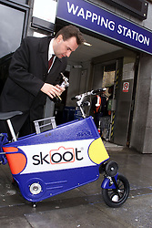 John Naish road tests the Skoot the fold up bike, UK, April 26, 2000. Photo by Andrew Parsons / i-images..