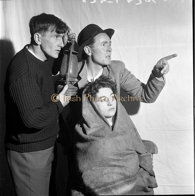 "05/04/1962<br /> 04/05/1962<br /> 05 April 1962<br /> Two plays at Damer Hall, Dublin for Gael-Linn. The plays were two Oireachtas prize-winning plays ""Na Mairnealaigh"" by Eoghan O Tuairisc and ""Stailc Ocrais"" by Mired Ni Ghrada. Image shows a scene from ""Na Mairnealaigh"" featured (l-r) are:  Tomas Ó Dubhghaill (as Fritz); Mairín Crookes (as An Dean-Bean) and Seosamh Mac an Ríogh (as An Sean Fhear)."