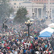 Smoke rises at 4:20 as thousands of participants smoke marijuana at the Civic Center Park rally.
