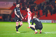 Alex Mowatt of Barnsley (27) reacts with Cauley Woodrow of Barnsley (9) at the full time whistle during the EFL Sky Bet League 1 match between Doncaster Rovers and Barnsley at the Keepmoat Stadium, Doncaster, England on 15 March 2019.
