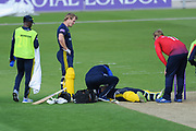 Rilee Rossouw of Hampshire receives treatment after injuring his wrist  during the Royal London One Day Cup match between Hampshire County Cricket Club and Essex County Cricket Club at the Ageas Bowl, Southampton, United Kingdom on 23 May 2018. Picture by Dave Vokes.