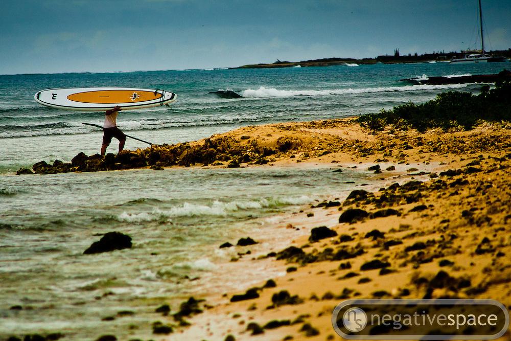 Paddle surfer going home, Palm Beach, Aruba