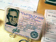 Artifacts - including a driver's license -belonging to the martyr Archbishop Oscar Romero on display in the priests residence turned museum across from the Church of the Divine Providence. The Archbishop was slain at the alter of his Church of the Divine Providence by a right wing gunman in 1980. Óscar Arnulfo Romero y Galdámez was a bishop of the Catholic Church in El Salvador. He became the fourth Archbishop of San Salvador, succeeding Luis Chávez, and spoke out against poverty, social injustice, assassinations and torture. Romero was assassinated while offering Mass on March 24,1980.. - To license this image, click on the shopping cart below -