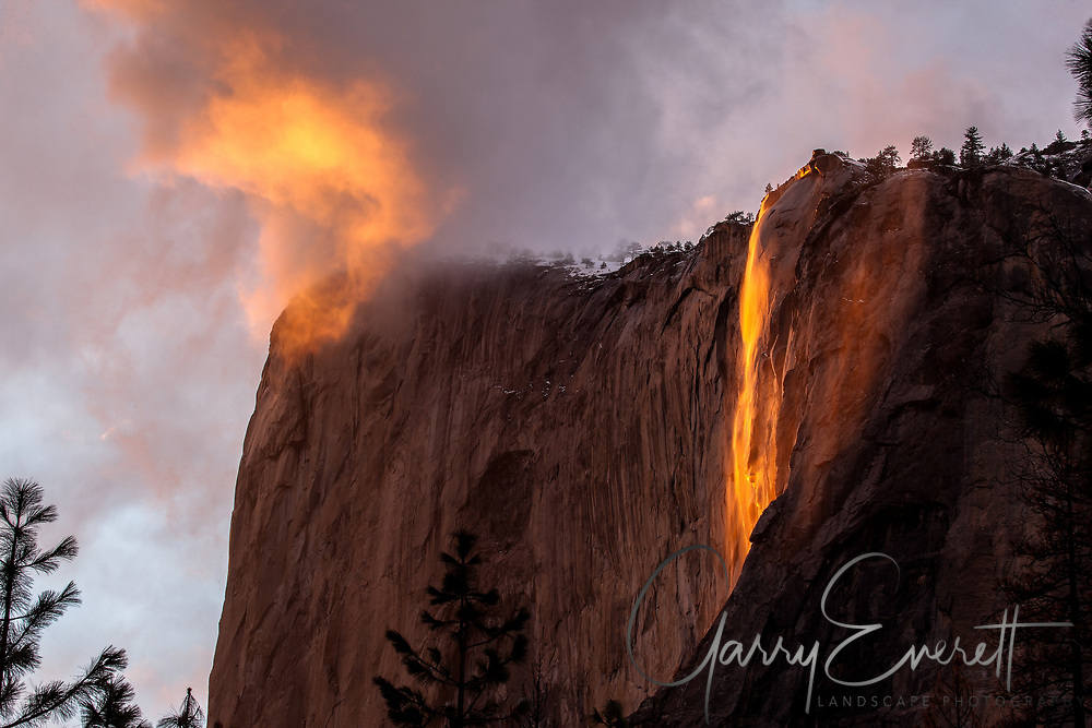 Sunset Horsetail Falls with cloud in front of El Capitan, Yosemite NP