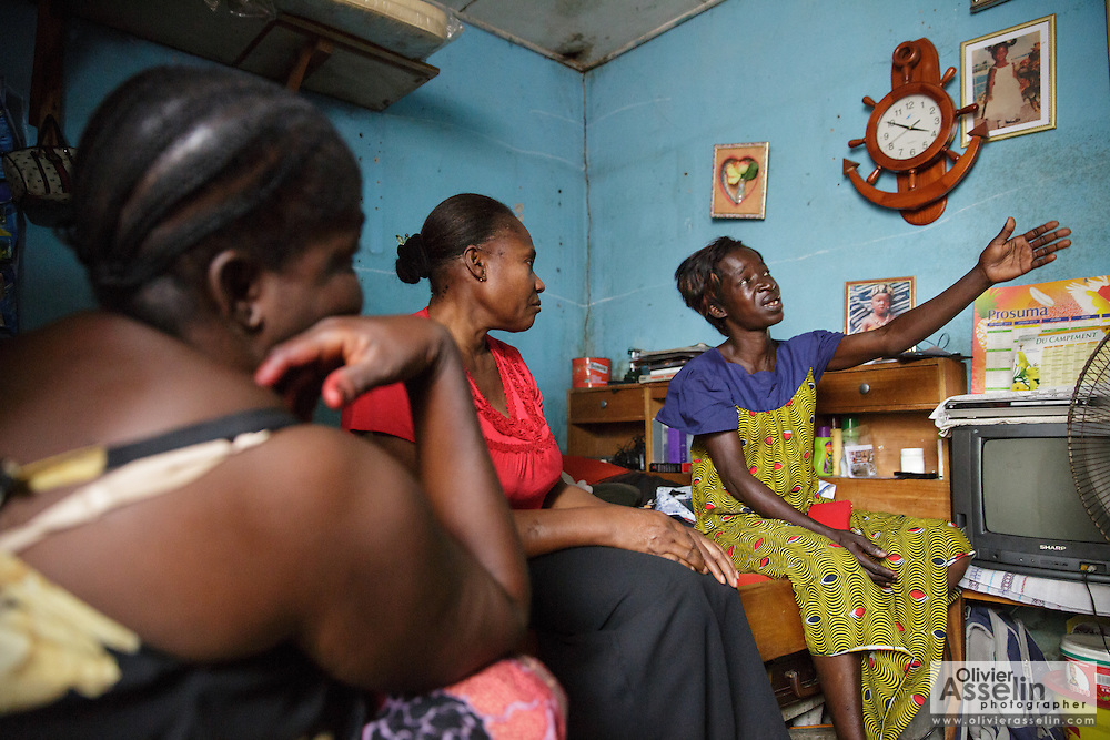 Counselor Kakou Amoin from UNICEF partner NGO Femme Active (center), discusses with Adjua Yao, 45, who is HIV positive, during a home visit in the Campement neighborhood of Abidjan, Cote d'Ivoire on Wednesday July 10, 2013. Adjua, a mother of five, is currently unemployed and lives with her sister. Counselors from Femme Active follow women living with HIV to make sure they have all the information and get proper treatment. At left is Adjua's sister Amena Yao, 47.