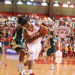 Jan 31, 2009; Piscataway, NJ, USA; Rutgers guard Epiphanny Prince (10) is flagrantly fouled by South Florida center Jessica Lawson (23) during the closing minutes of South Florida's 59-56 victory over Rutgers in NCAA women's college basketball at the Louis Brown Athletic Center