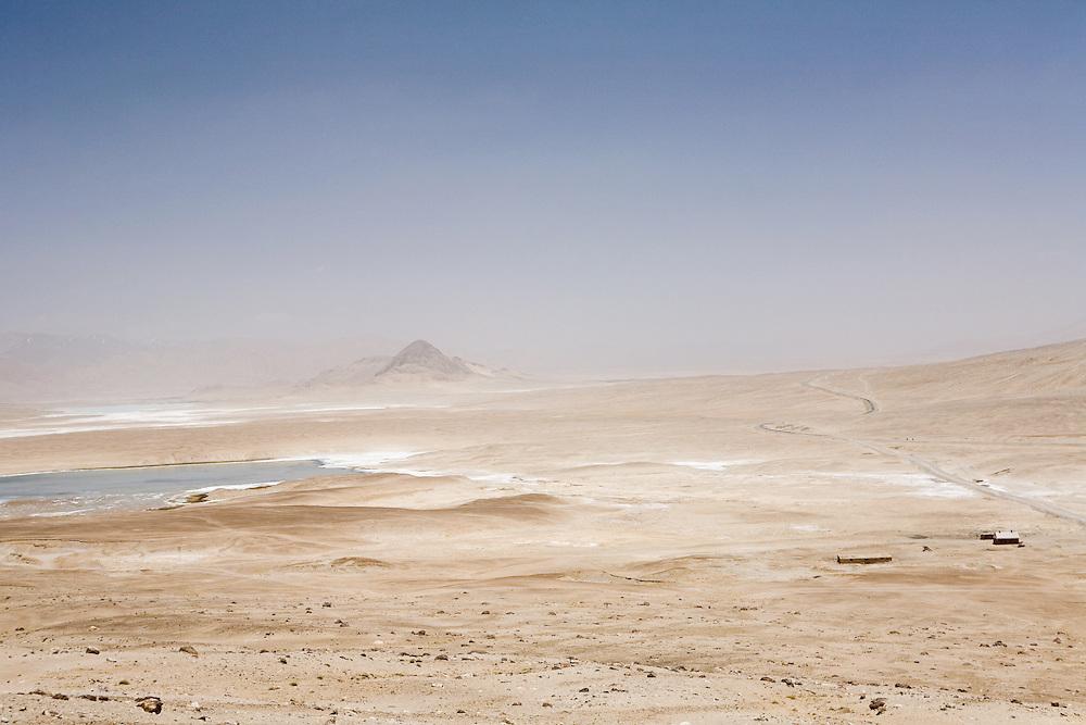 Desolate moonscape along high-altitude Pamir Highway, Tajikistan