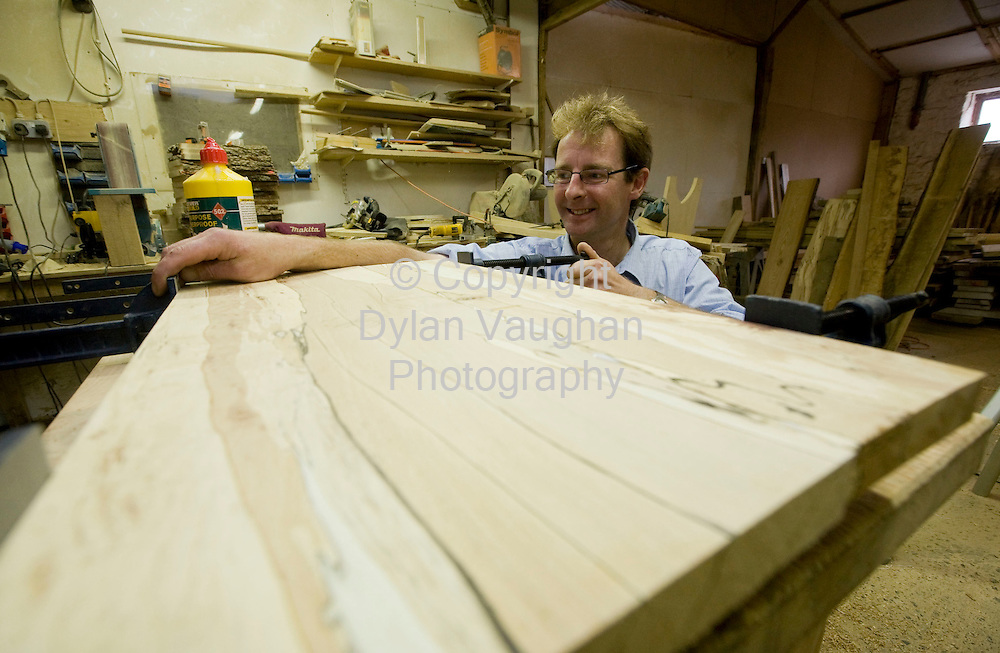 29/8/2008.William Bunbury  pictured clamping and joining some spalted beech at Lisnavagh House in Carlow.Picture Dylan Vaughan.
