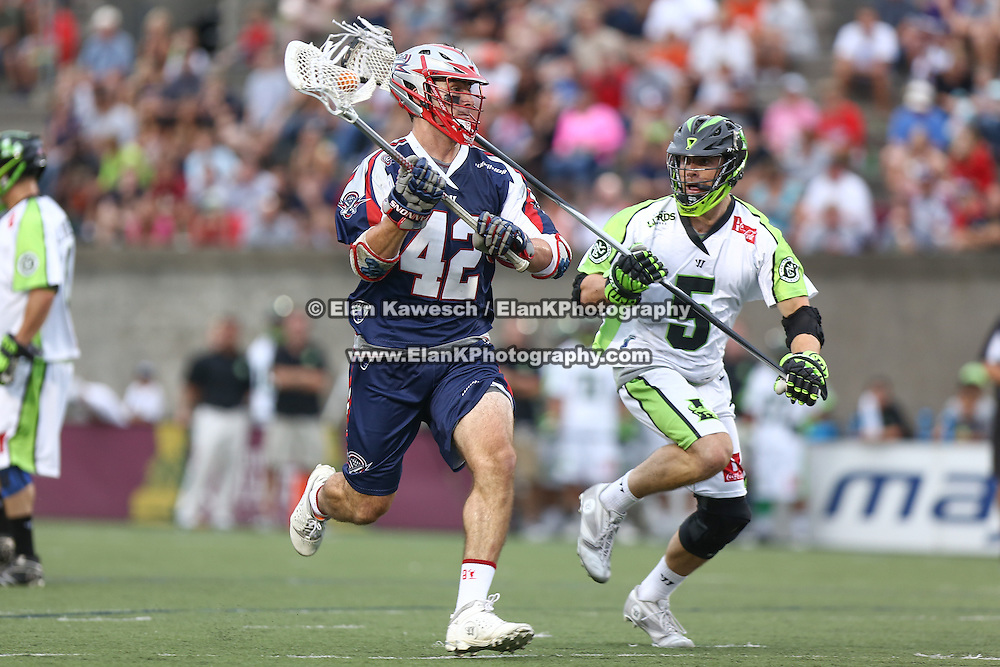 Action is seen during the game between the Boston Cannons and the New York Lizards at Harvard Stadium on July 19, 2014 in Boston, Massachusetts. (Photo by Elan Kawesch)