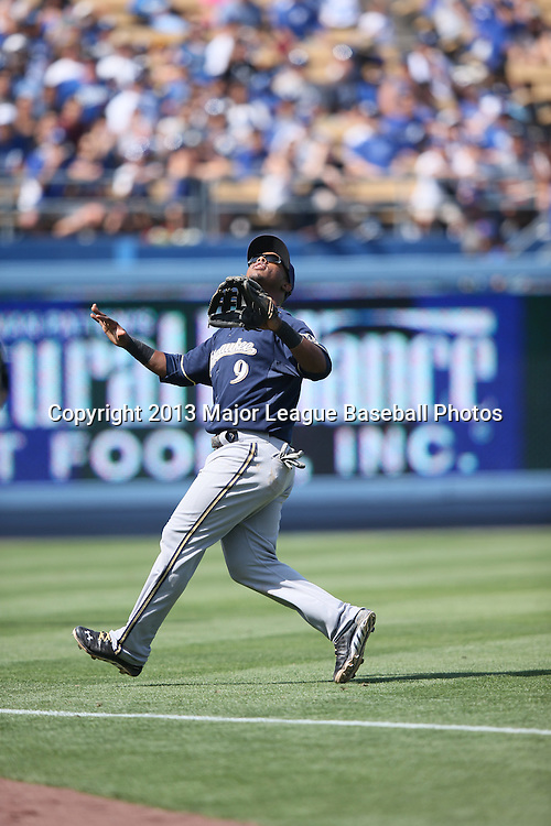 LOS ANGELES, CA - APRIL 28:  Jean Segura #9 of the Milwaukee Brewers catches a fly ball for the first out in the bottom of the eighth inning during the game against the Los Angeles Dodgers on Sunday, April 28, 2013 at Dodger Stadium in Los Angeles, California. The Dodgers won the game 2-0. (Photo by Paul Spinelli/MLB Photos via Getty Images) *** Local Caption *** Jean Segura