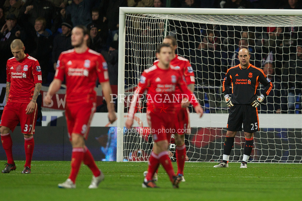 BOLTON, ENGLAND - Saturday, January 21, 2011: Liverpool's goalkeeper Jose Reina looks dejected as Bolton Wanderers score the third goal during the Premiership match at the Reebok Stadium. (Pic by David Rawcliffe/Propaganda)