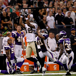 September 9, 2010; New Orleans, LA, USA;  New Orleans Saints wide receiver Marques Colston (12) goes up for a pass as Minnesota Vikings cornerback Asher Allen (21) and safety Husain Abdullah (39) defend on the play during the NFL Kickoff season opener at the Louisiana Superdome. The New Orleans Saints defeated the Minnesota Vikings 14-9.  Mandatory Credit: Derick E. Hingle