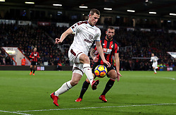 Burnley's Chris Wood (left) and AFC Bournemouth's Steve Cook (right) battle for the ball during the Premier League match at the Vitality Stadium, Bournemouth.