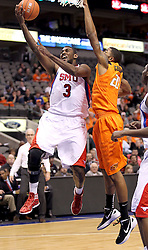 SMU forward Leslee Smith (3) drives to the basket against Oklahoma State forward Michael Cobbins (20) in the first half of an NCAA basketball game in Dallas, Wednesday, Dec. 28, 2011. Oklahoma St won 68-58.