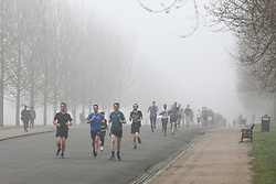 © Licensed to London News Pictures. 23/02/2019. London, UK. Hundreds of park runners running in thick fog in Finsbury Park, north London. According to the Met Office London's temperatures is likely to reach 15 degrees celsius and UK could break records this weekend, with high pressure from Europe bringing dry and sunny weather. Photo credit: Dinendra Haria/LNP