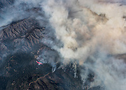 An air tanker drops fire retardant on the mountains below as the fire continues to rage. ©2016 Sivani Babu
