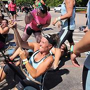 Shari Cirrito, (centre),  in action during the Reebok Spartan Race. Mohegan Sun, Uncasville, Connecticut, USA. 28th June 2014. Photo Tim Clayton