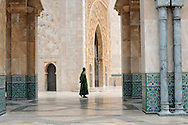 Morocco, Casablanca. Moroccan man at the courtyard of the Hassan II Mosque.
