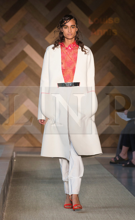 © Licensed to London News Pictures. 29/05/2014. London, England. Collection by Louise Annis. 30 students of the Royal College of Art's prestigious MA Fashion programme presented their final collections in  a runway show at the RCA building in Kensington. Photo credit: Bettina Strenske/LNP