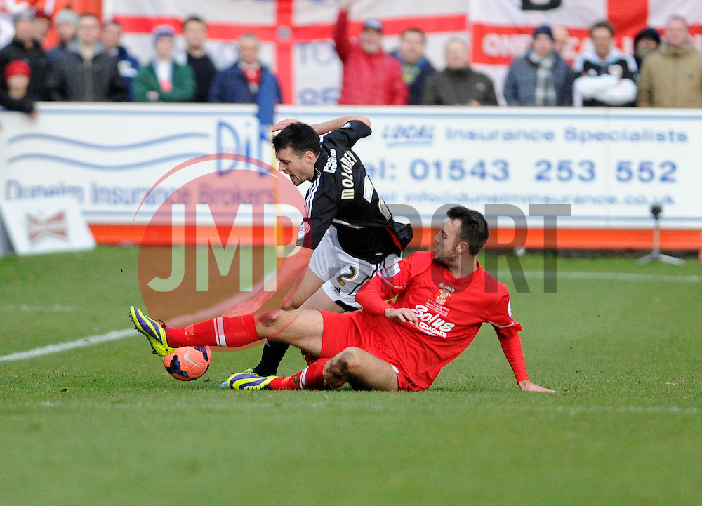 Bristol City's Brendan Moloney is tackled by Tamworth's Tony Capaldi - Photo mandatory by-line: Dougie Allward/JMP - Tel: Mobile: 07966 386802 08/12/2013 - SPORT - Football - Tamworth - The Lamb Ground - Tamworth v Bristol City - FA Cup - Second Round