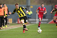 Tom Naylor of Burton Albion in action during the Sky Bet League 1 match between Burton Albion and Oldham Athletic at the Pirelli Stadium, Burton upon Trent, England on 26 March 2016. Photo by Brandon Griffiths.