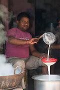 Straining milk<br /> Bharatpur<br /> Rajasthan, India