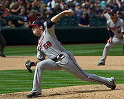 Minnesota Twins pitcher, Caleb Thielbar hurls a fast ball towards home plate during a match up against the Seattle Mariners. Photo by John Lill