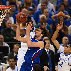 Apr 2, 2012; New Orleans, LA, USA; Kansas Jayhawks center Jeff Withey (5) goes up for a shot as Kentucky Wildcats forward Terrence Jones (behind) and forward Anthony Davis (23) defend during the first half in the finals of the 2012 NCAA men's basketball Final Four at the Mercedes-Benz Superdome. Mandatory Credit: Derick E. Hingle-US PRESSWIRE