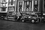 17/03/1965<br /> 03/17/1965<br /> 17 March 1965<br /> NAIDA St. Patrick's Day Parade, Dublin. Fiat Fl8 bulldozer on a McCairns Motors Ltd. carrier passing down D'Olier Street, shot for Gowran Steel Works.