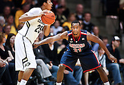 SHOT 1/21/12 6:39:31 PM - Colorado's Spencer Dinwiddie #25 looks to pass in front of Arizona's Kyle Fogg #21 during their PAC 12 regular season men's basketball game at the Coors Events Center in Boulder, Co. Colorado won the game 64-63..(Photo by Marc Piscotty / © 2012)
