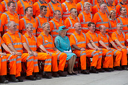 Image ©Licensed to i-Images Picture Agency. 17/07/2014. Reading, United Kingdom. HM The Queen opens Reading Railway Satation and poses for a group photo with Network Rail workers Picture by i-Images