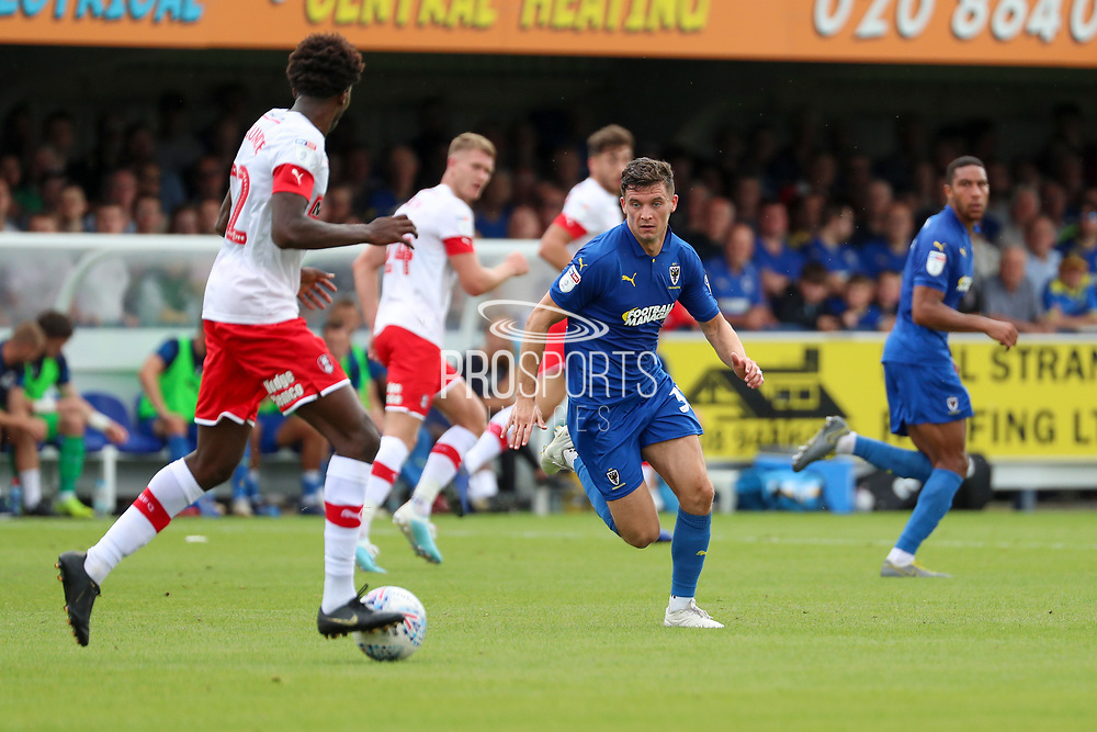 AFC Wimbledon midfielder Callum Reilly (33) chasing down the ball during the EFL Sky Bet League 1 match between AFC Wimbledon and Rotherham United at the Cherry Red Records Stadium, Kingston, England on 3 August 2019.