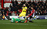 Brentford goalkeeper David Button with a save from Leeds United striker Mirco Antenucci during the Sky Bet Championship match between Brentford and Leeds United at Griffin Park, London, England on 26 January 2016. Photo by Matthew Redman.