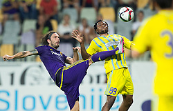 Marko Suler #4 of Maribor vs Junior Kabananga of Astana during First Leg football match between NK Maribor and FC Astana in Second qualifying round of UEFA Champions League, on July 14, 2015 in Stadium Ljudski vrt, Maribor, Slovenia. Photo by Vid Ponikvar / Sportida