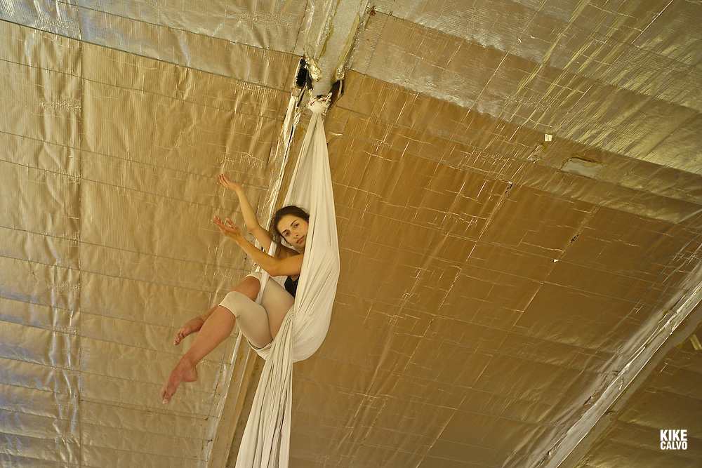Model relased photo of Colombian professional dancer Carolina performing aerial dancing in a dance studio in Bogota.